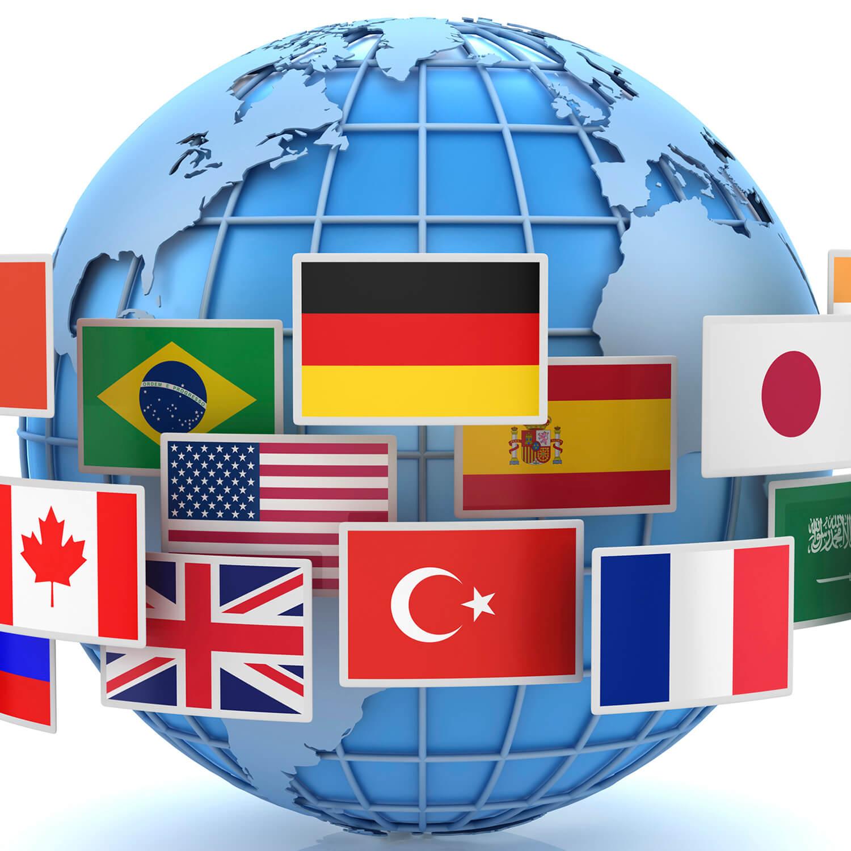 Flagi różnych krajów na tle kuli ziemskiej